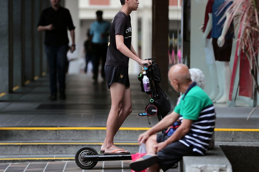 A man on e-scooter riding on a footpath at Chinatown on Nov 5, 2019.