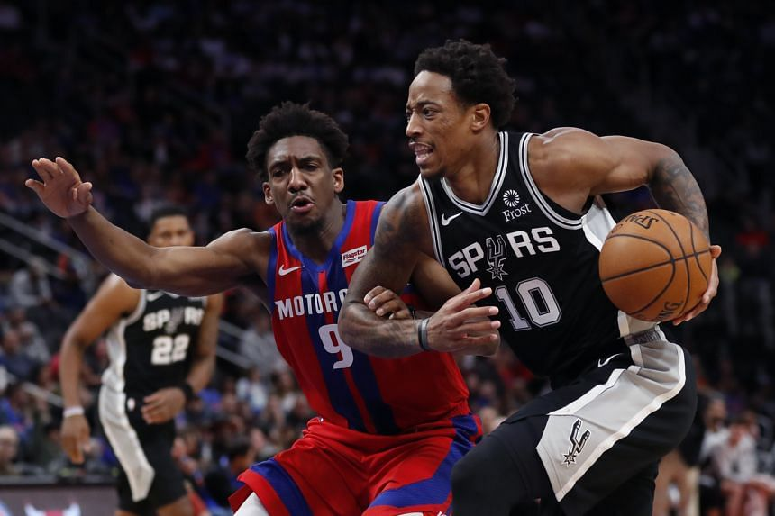 San Antonio Spurs guard DeMar DeRozan (10) drives on Detroit Pistons guard Langston Galloway (9), on Dec 1, 2019.