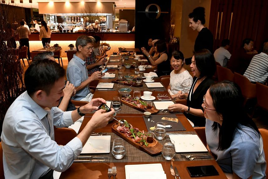 Straits Times subscribers and their guests at Osia Steak and Seafood Grill (above).
