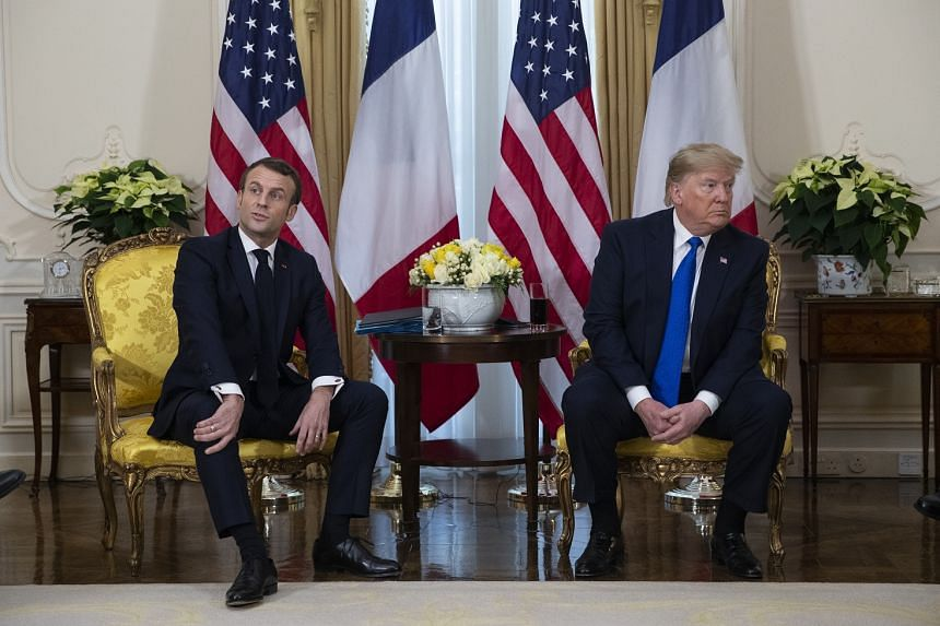 President Donald Trump (right) meets French President Emmanuel Macron during the Nato summit.