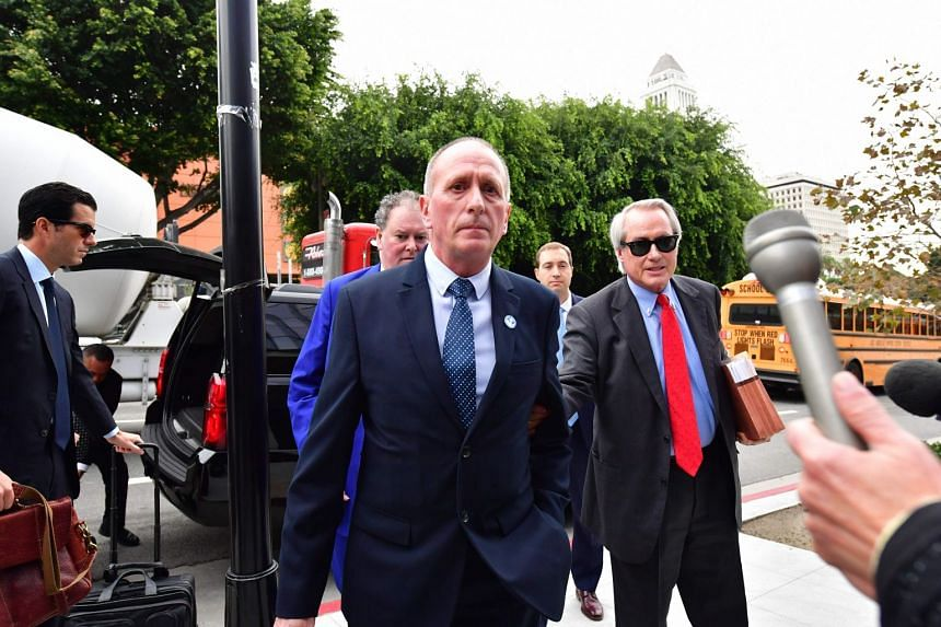 British cave diver Vern Unsworth (centre) arrives at US District Court in Los Angeles with his attorney Lin Wood (right).