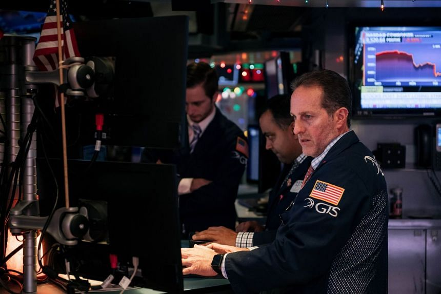 A trader checks stock prices on the floor of the New York Stock Exchange on Dec 3, 2019.