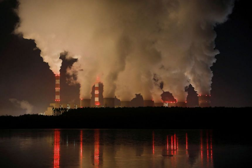 In a file photo taken on Dec 5, 2018, smoke and steam billows from Belchatow Power Station, Europe's largest coal-fired power plant operated by PGE Group, in Poland.