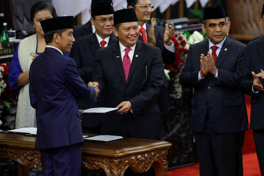 Indonesian President Joko Widodo is greeted by People's Consultative Assembly Speaker Bambang Soesatyo during the presidential inauguration in Jakarta on Oct 20, 2019.