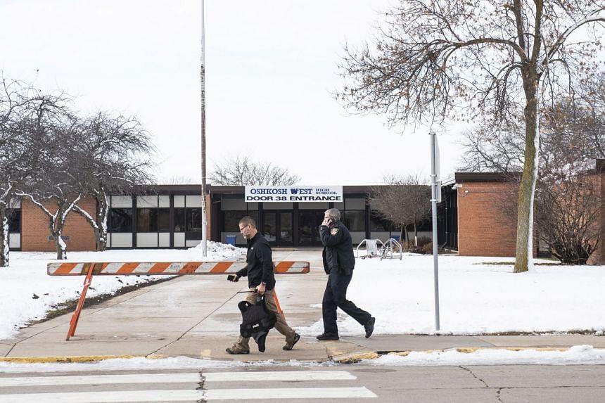 Police officers outside Oshkosh West High School in Oshkosh, Wisconsin.