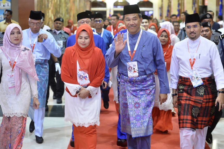 Umno deputy president Datuk Seri Mohamad Hasan (second from right) arrvies at the opening of Umno, Wanita, Youth and Puteri (young women) wings assembly in Kuala Lumpur on Dec 4, 2019.