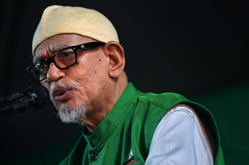 In a file photo taken on May 2, 2018, Abdul Hadi Awang, president of Islamist party Parti Islam SeMalaysia, speaks at an election rally in Alor Setar, Kedah.