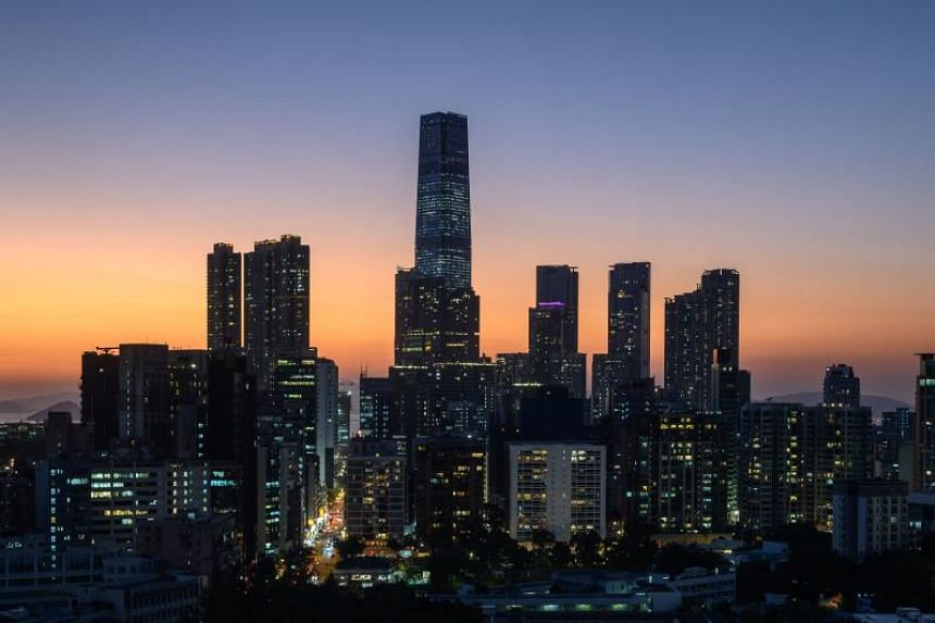 In a photo taken on Nov 22, 2019, the skyline of Hong Kong's Kowloon district is seen at sunset.