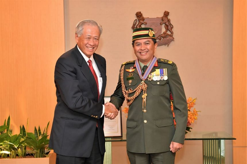 Minister for Defence Ng Eng Hen congratulating Commander of the Royal Brunei Land Forces, Brigadier-General Awang Khairul Hamed bin Awang Haji Lampoh. at the Ministry of Defence on Dec 4, 2019.