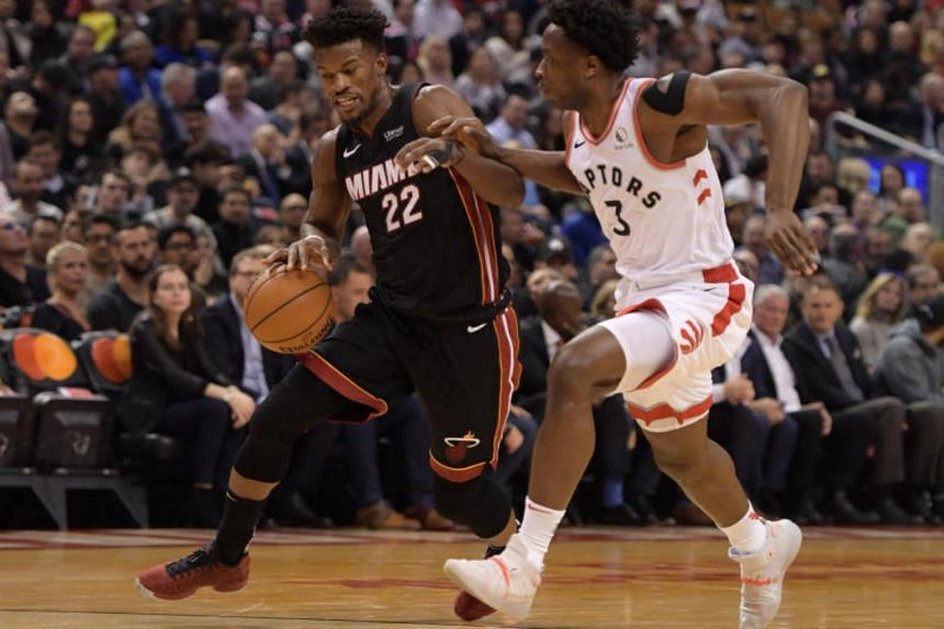 Miami Heat forward Jimmy Butler (22) dribbles the ball as Toronto Raptors forward OG Anunoby (3) defends in the first half at Scotiabank Arena on Dec 3, 2019.