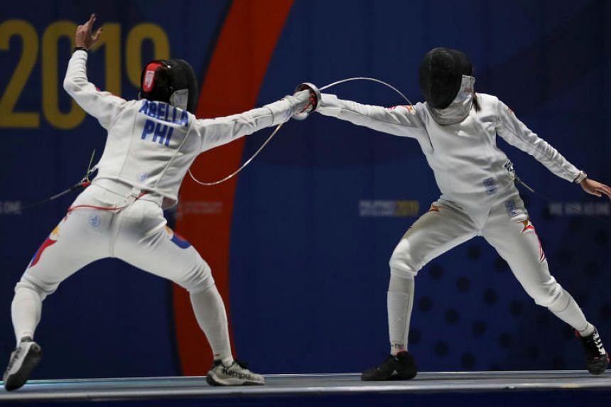 Kiria Tikanah Abdul Rahman (right) emerged victorious in the women's individual epee final on SEA Games in Philippines on Dec 4, 2019.
