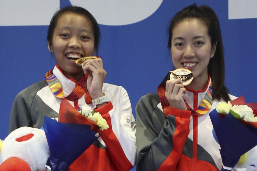 Fencer Kiria Tikanah (left) emerged victorious in the women's individual epee final.