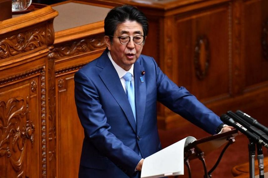 In a photo taken on Nov 20, 2019, Japan's Prime Minister Shinzo Abe answers questions during a House of Councillors plenary session in Tokyo.