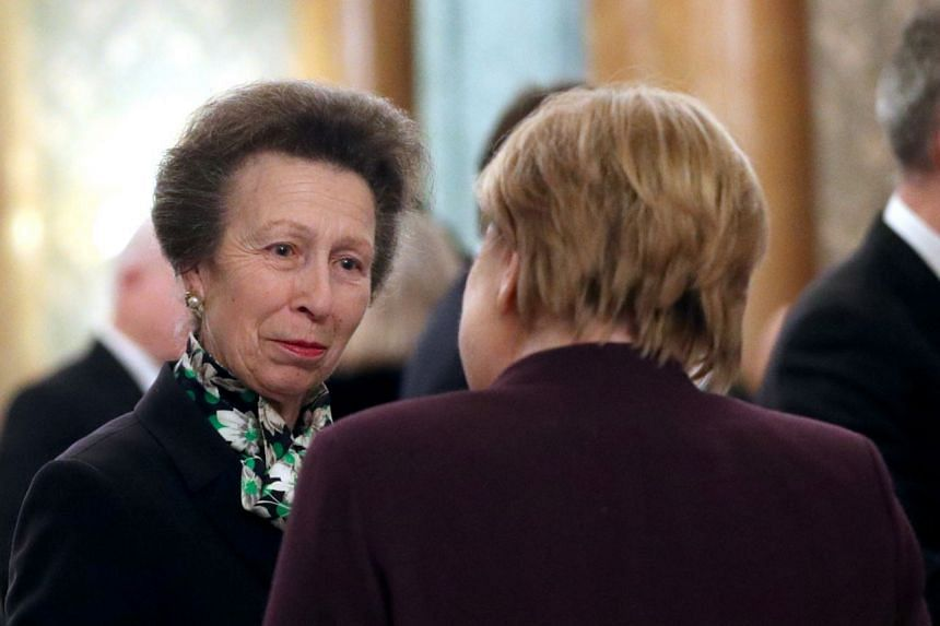 Princess Anne (left) talks to German Chancellor Angela Merkel during a reception at Buckingham Palace to mark 70 years of the Nato alliance.