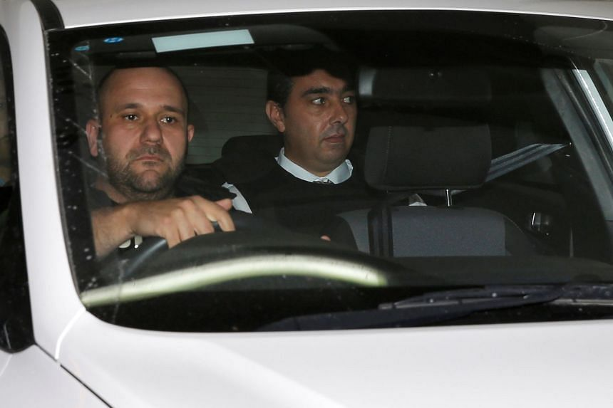 Melvin Theuma is seen in a police car as he leaves the Courts of Justice in Valletta.