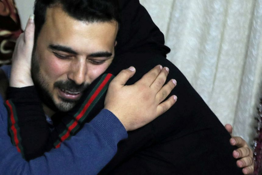 Amjad Yaghi hugging his mother, Nevine Zouheir, after 20 years of separation.