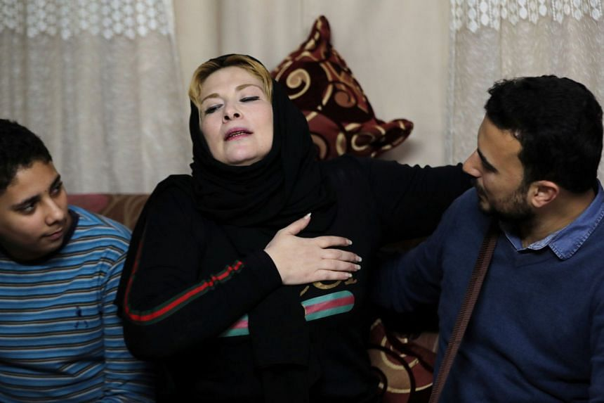 Nevine Zouheir, a Palestinian, reacts during an emotional reunion with her son, Amjad Yaghi.