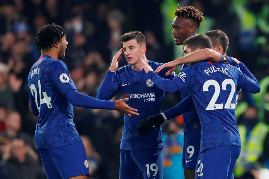 Chelsea's Tammy Abraham celebrates scoring their first goal with team mates.