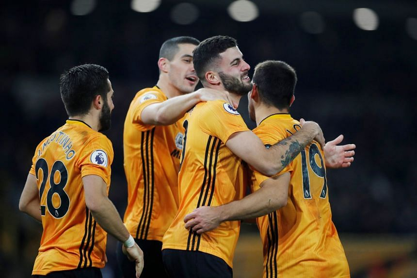 Wolverhampton Wanderers' Patrick Cutrone celebrates scoring their second goal with team mates.