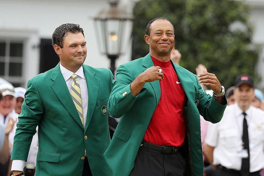 Tiger Woods basking in fans' adulation at the Masters in April after last year's champion Patrick Reed helps him wear the Green Jacket. It was Woods' fifth Masters win and 15th Major triumph, 11 years after his last.