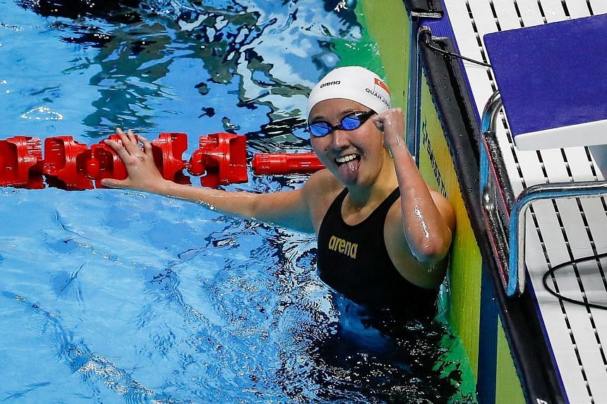 Top: The youngest of the Quah siblings, Jing Wen, started the gold rush in the pool by retaining her 200m butterfly title in the first final. Above: Ting Wen, the eldest, set a 100m freestyle SEA Games record of 54.74sec, taking 0.01 off the time she