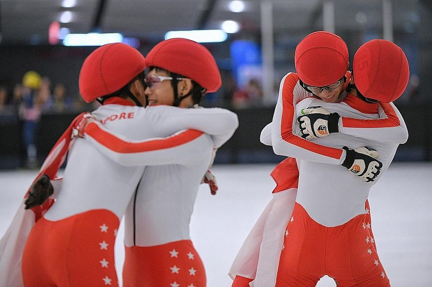 Above, from left: Trevor Tan, Lucas Ng, Zen Koh and Xu Jing Feng embracing after winning the men's short-track speed skating 3,000m relay final yesterday. Left: Cheyenne Goh leading the pack in the women's 1,000m final. She won her second gold and th