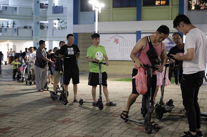 People waiting in line to dispose of their e-scooters last month. Owners of registered e-scooters receive $100 for early disposal of non-compliant devices. The Ministry of Transport has accepted all the recommendations made by the Active Mobility Adv