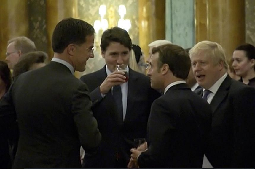 This video screengrab from a reception for Nato leaders at Buckingham Palace on Tuesday shows (from left) Dutch Prime Minister Mark Rutte, Canadian Prime Minister Justin Trudeau, French President Emmanuel Macron and British Prime Minister Boris Johns