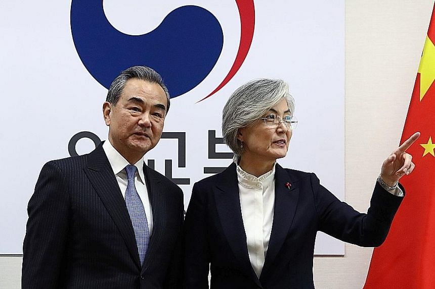 South Korean Foreign Minister Kang Kyung-wha (right) with Chinese State Councillor Wang Yi during their meeting in Seoul yesterday. PHOTO: REUTERS