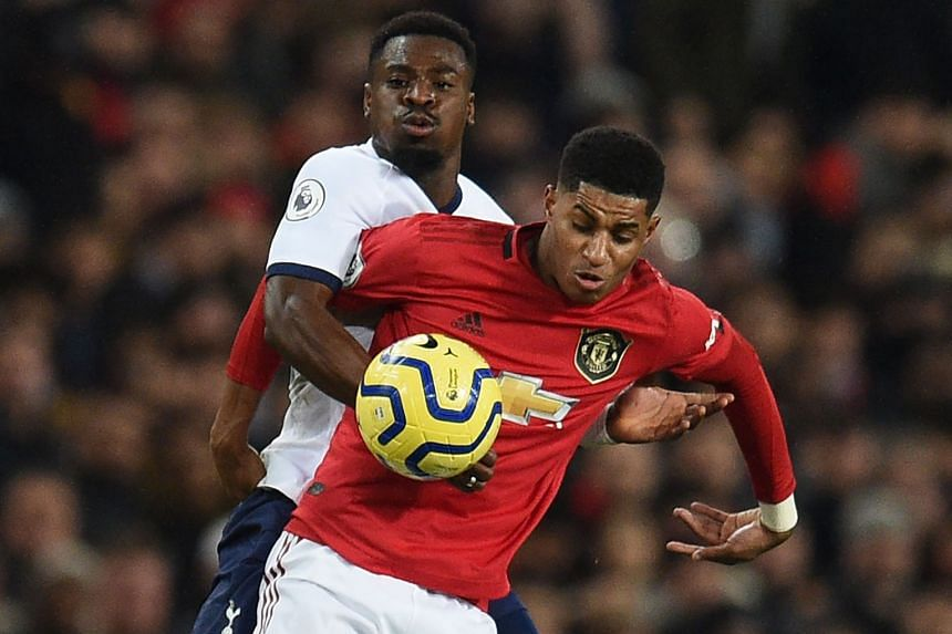 Tottenham's Serge Aurier (left) vies with Manchester United's English striker Marcus Rashford.