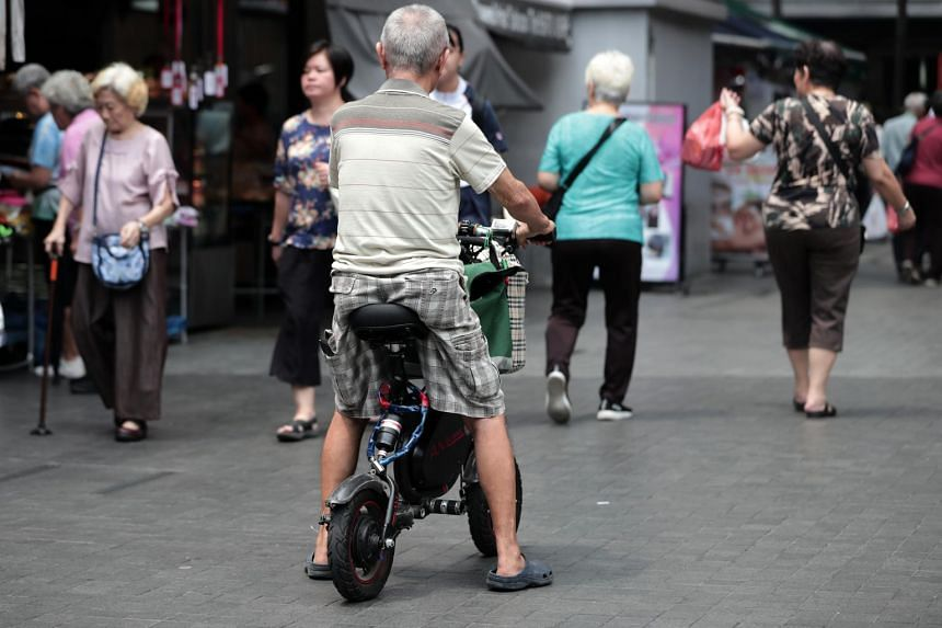 An elderly man rides a PMD on the footpath at Clementi on Nov 5, 2019.