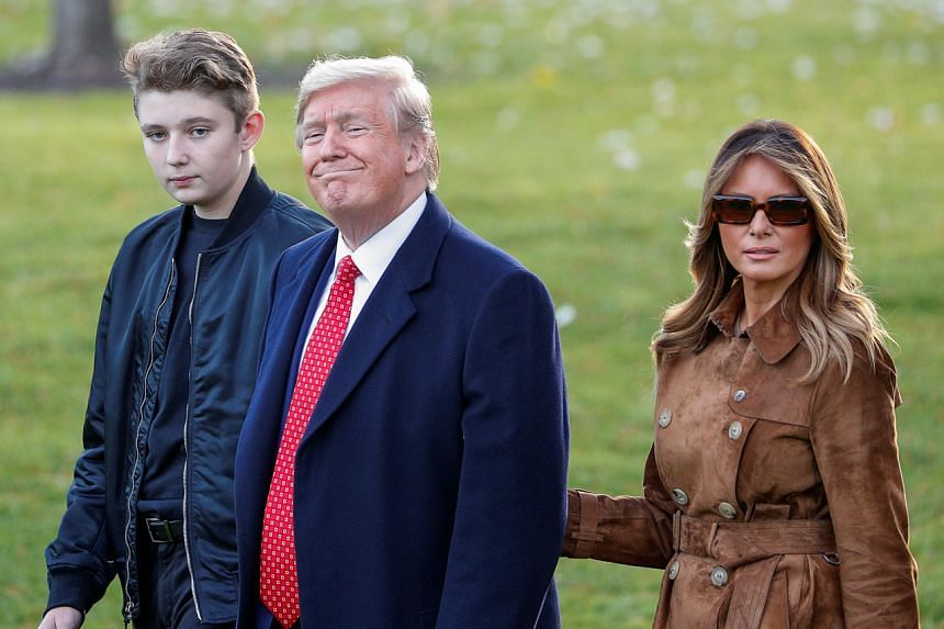 In a photo from Nov 26, 2019, first lady Melania Trump walks with her son Barron and US President Donald Trump at the White House.