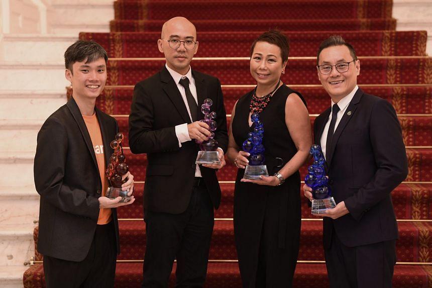 (From left) Bantu's Mr Nicholas Ooi, Samsui Supplies & Services' Mr Ang Kian Peng, DBS Bank's Ms Karen Ngui and Social Enterprise Champion of the Year (Individual) award winner Don Wong.