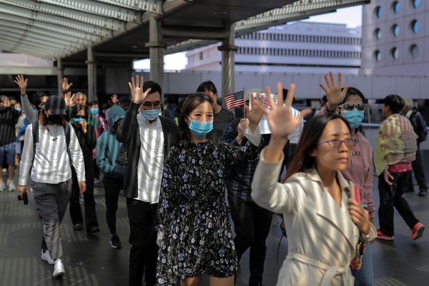 Anti-government office workers attend a lunchtime protest in Hong Kong on Nov 28, 2019.
