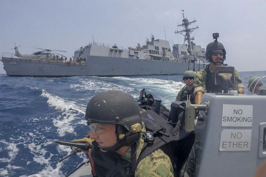 In a photo taken on Sept 15, 2019, US Navy sailors ride a rigid-hull inflatable boat (RHIB) from the Arleigh Burke-class guided-missile destroyer USS Wayne E. Meyer's (DDG 108).