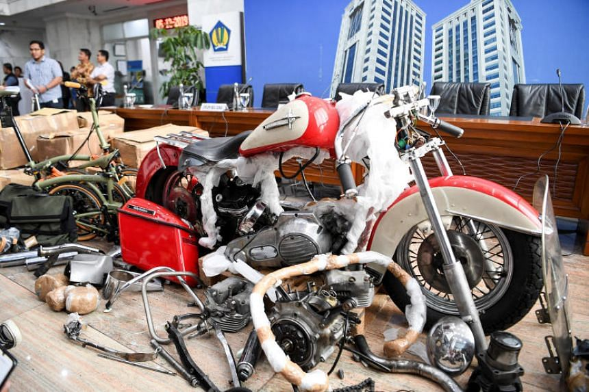 The undeclared Harley Shovelhead and one of two high-end Brompton folding bikes which were brought into Indonesia on a Garuda Indonesia flight.