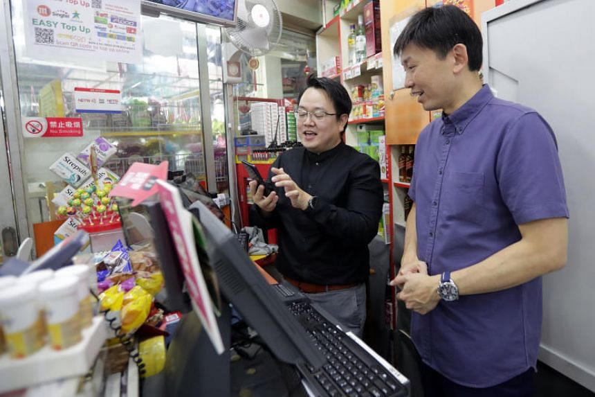 In a photo taken on Nov 25, 2019, Senior Minister of State for Trade and Industry Chee Hong Tat visits Kim Eng Mini Supermarket during a walkabout at Chong Pang City in Yishun.