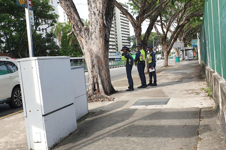 Land Transport Authority enforcement officers patrolling outside Braddell MRT station on Dec 5, 2019.