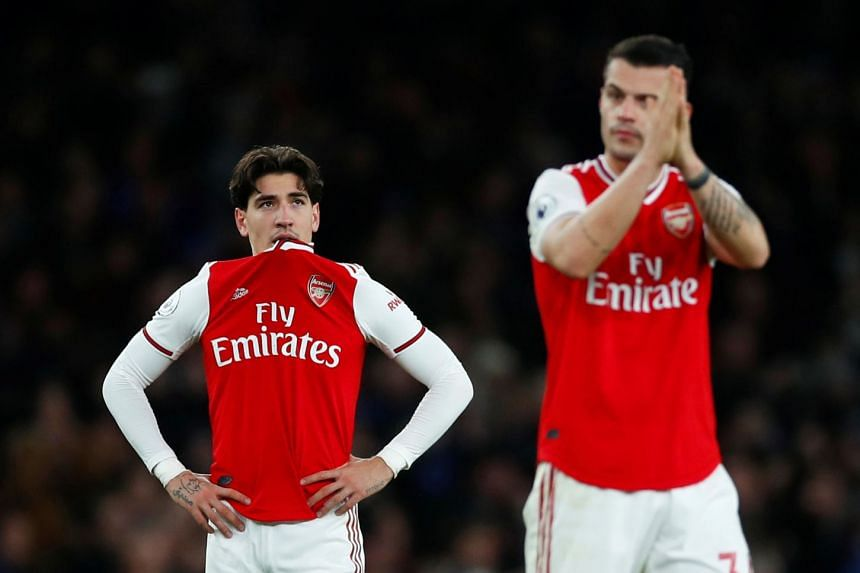 Arsenal's Hector Bellerin looks dejected after the match.