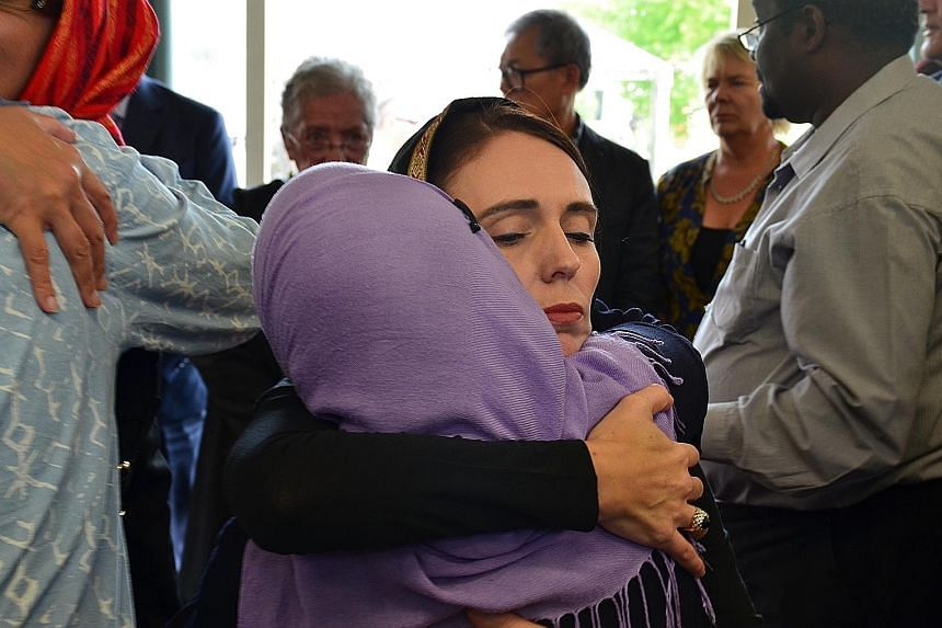 New Zealand PM Jacinda Ardern with members of the Muslim community in the wake of the mass shooting that killed 51 worshippers at two Christchurch mosques on March 16. PHOTO: EPA-EFE