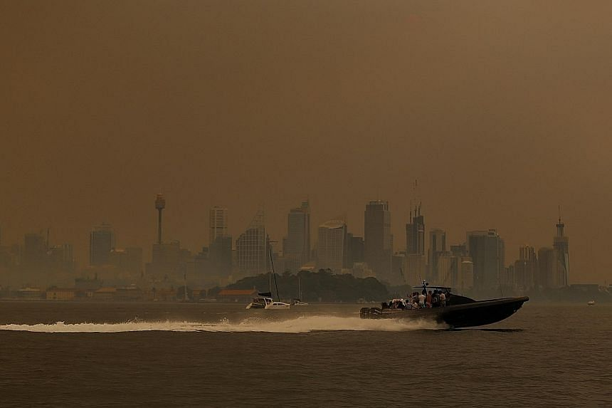 """Smoke haze from bush fires in New South Wales engulfing Sydney yesterday. As bush fires ravage Australia's east coast, pollution is becoming a regular occurrence. Pockets of Sydney ranked worse than Shanghai yesterday, with one suburb showing a """"very"""