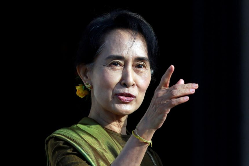 In a photo taken on Oct 24, 2013, Myanmar leader Aung San Suu Kyi arrives at Parliament buildings on the Stormont estate in Belfast, Northern Ireland.
