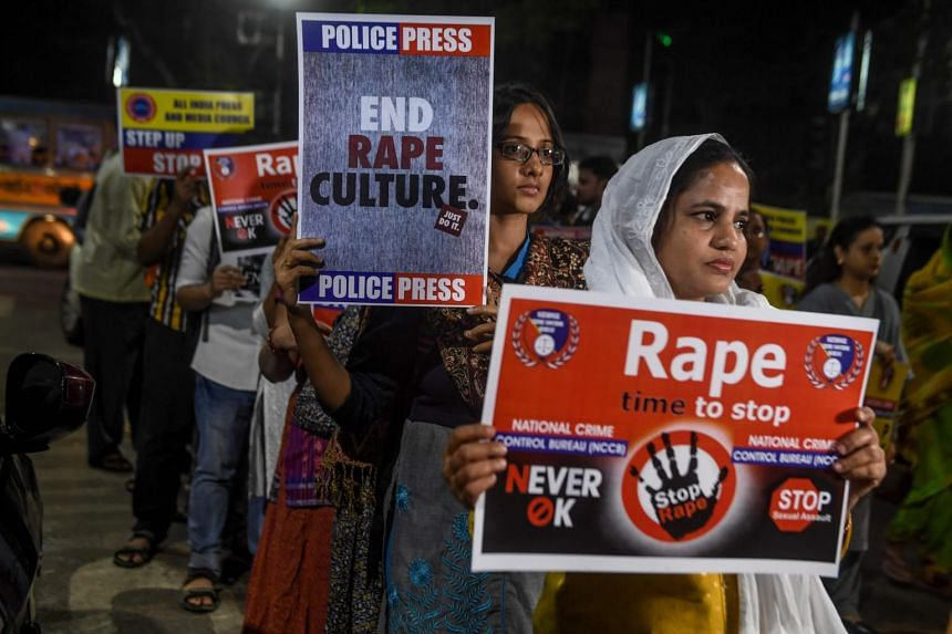 Demonstrators hold placards to protest against sexual assaults on women, following the alleged gang-rape and murder of a veterinarian in Hyderabad, during a march in Kolkata on Dec 4, 2019.