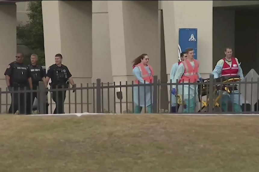 A video grab image shows emergency responders near the Naval Air Base Station in Pensacola, Florida.