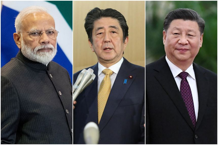 """In the six Asia-Pacific countries surveyed, most have little confidence in Chinese President Xi Jinping (right) when it comes to """"world affairs"""" than Indian Prime Minister Narendra Modi (left) and Japanese Prime Minister Shinzo Abe."""