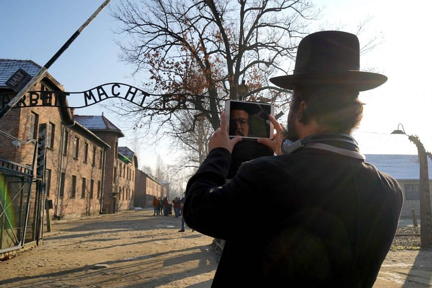 Angela Merkel warns of new wave of anti-Semitism as she visits Auschwitz