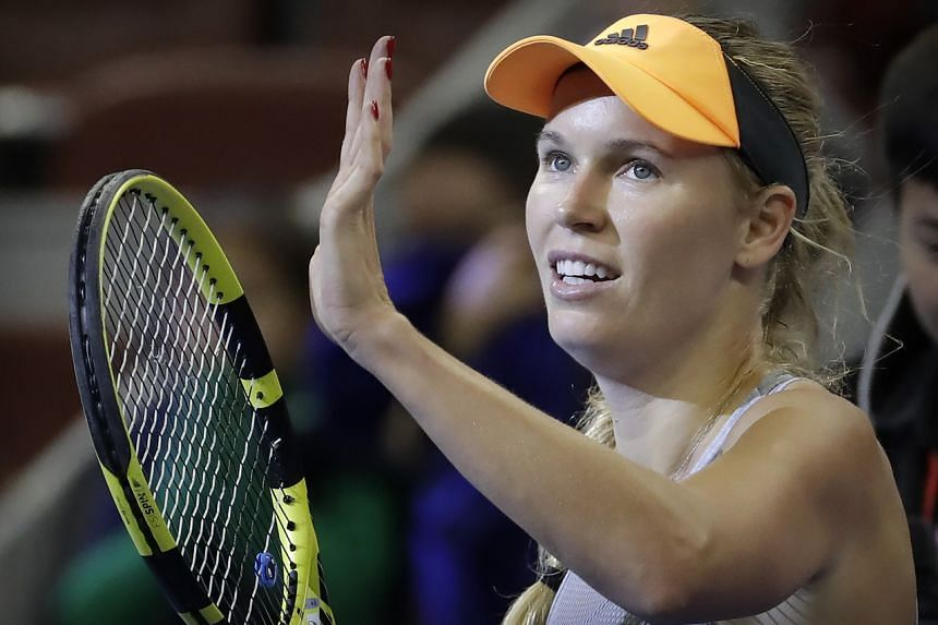 In a file photo taken on Oct 4, 2019, Caroline Wozniacki reacts after beating Russia's Daria Kasatkina in their quarterfinal match in the China Open tennis tournament in Beijing.