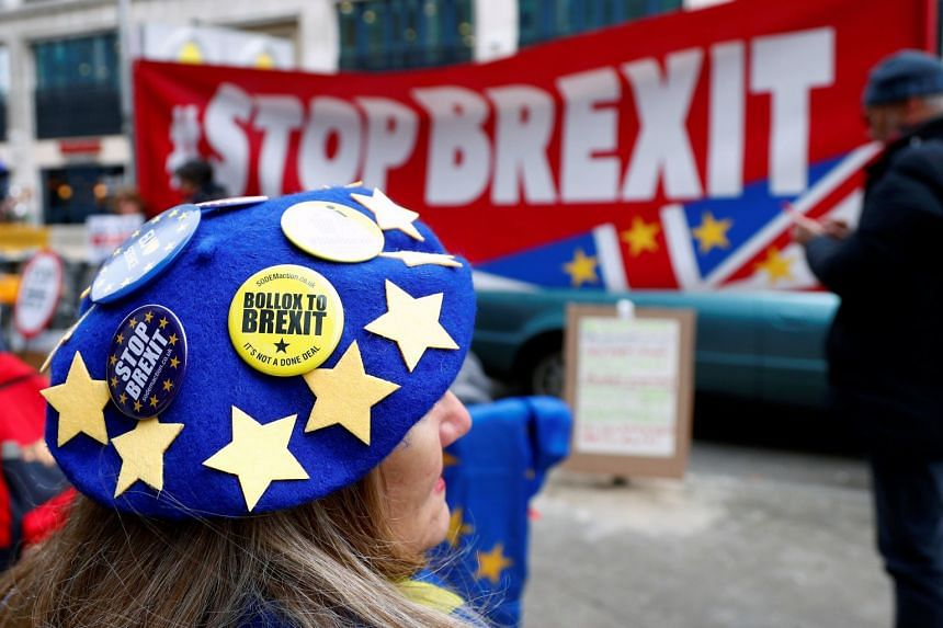 An anti-Brexit demonstrator protests in front of the British embassy in Brussels, Belgium.