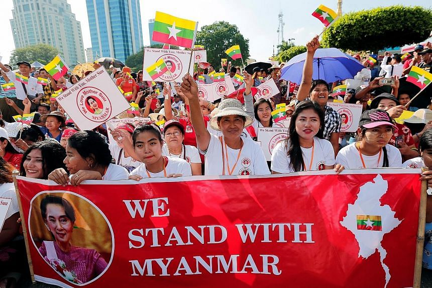 People rallying in support of Myanmar State Counsellor Aung San Suu Kyi in Yangon on Sunday, before her departure for the International Court of Justice in the Netherlands to face accusations of genocide.