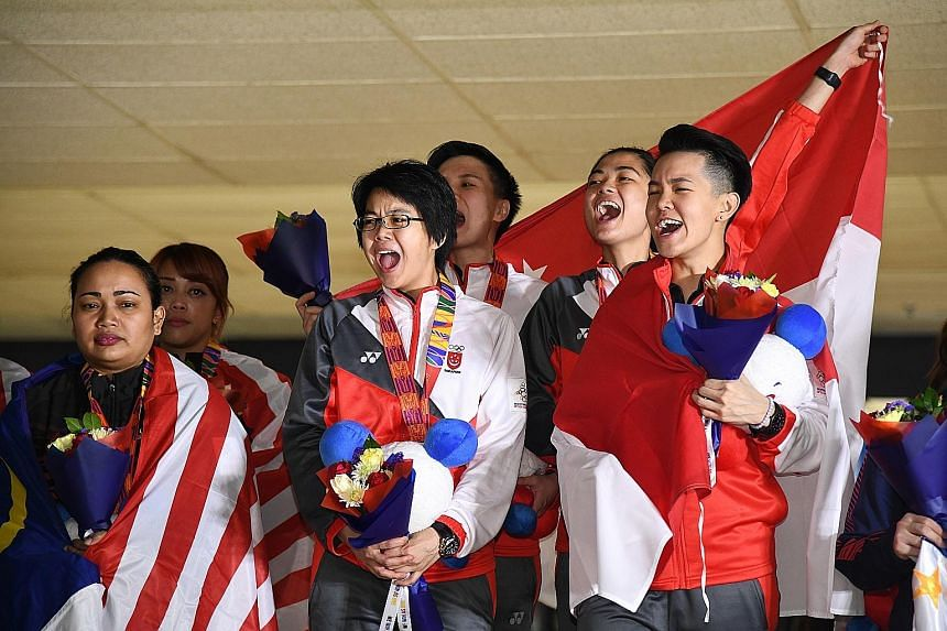Singapore bowlers (from right), Shayna Ng, Daphne Tan, New Hui Fen and Cherie Tan celebrating their gold medal yesterday. It was the first SEA Games women's team gold for Singapore since 2011.